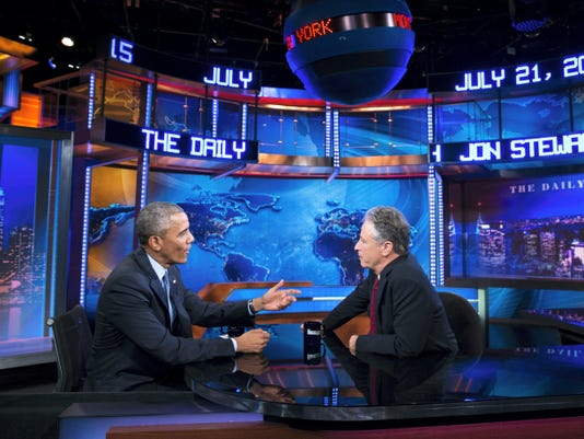 "President Barack Obama, left, talks with Jon Stewart, host of ""The Daily Show with Jon Stewart"" during a taping July 21 in New York. Stewart leaves the show Thursday after 16 years."