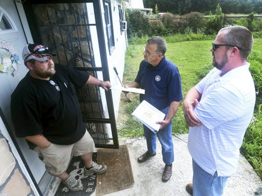 Terry Young, left, talks with Brent Coleman and Gary Anthony who travel door to door Friday as IAMAW Union organizers representing Letterkenny workers for Bowhead.