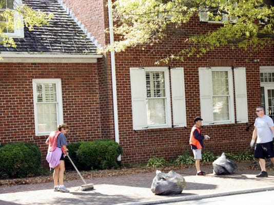 Volunteers take part in last year's Team Up to Clean Up event created by TrueNorth Wellness Services. The event will be part of this year's September Second Saturday, which Main Street Hanover developed to bring the community to downtown Hanover.