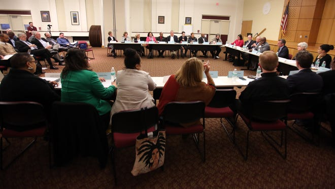 Gov. John Carney and Education Secretary Susan Bunting join a meeting of the Wilmington Education Improvement Commission Tuesday at the Sharp Conference Center.