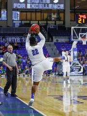 China Dow (22) pushes the ball back into play at the very last second against NJIT on Friday, March 2, 2018, at Alico Arena.
