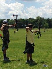 Archery participants Cameron Escoyne (L) and Joseph