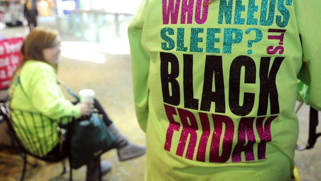 Sherrie Sturkie of Martin, Tenn., and other family members wear matching T-shirts during Black Friday shopping at CoolSprings Galleria.