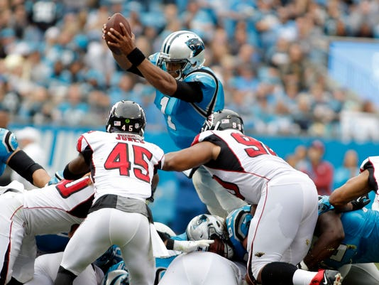 Carolina Panthers' Cam Newton (1) dives for a first down against the Atlanta Falcons in the second half of an NFL football game in Charlotte, N.C., Sunday, Nov. 5, 2017. (AP Photo/Bob Leverone)