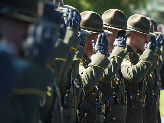 Members of the Vermont State Police pay their respects