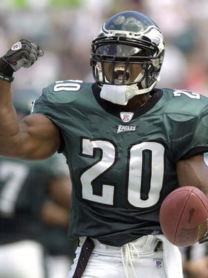 FILE - In this Sept. 29, 2002, file photo, Philadelphia Eagles safety Brian Dawkins reacts after making an interception in the third quarter against the Houston Texans, in Philadelphia. Brian Dawkins transformed from a calm, soft-spoken man into an action hero on game days for 16 seasons in the NFL. Dawkins will be inducted into the Hall of Fame during ceremonies in Canton, Ohio on Saturday, Aug. 4, 2018. (AP Photo/Chris Gardner, File)