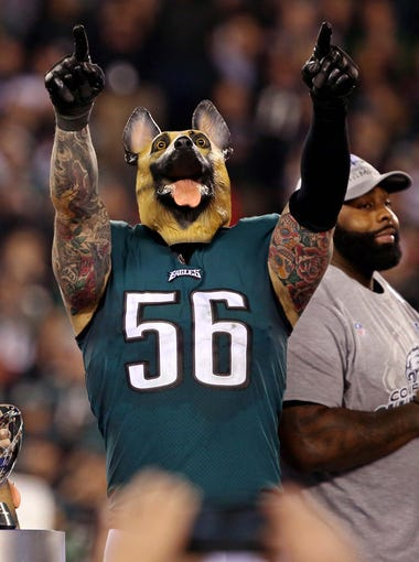 Philadelphia Eagles defensive end Chris Long celebrates with a dog mask on after beating the Minnesota Vikings in the NFC Championship Game at Lincoln Financial Field.