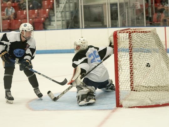 Blue All Star Corey Cllifton scores on White All Star