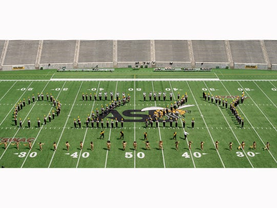 "The ASU Band spells out ""Ozzy"" in formation on the"