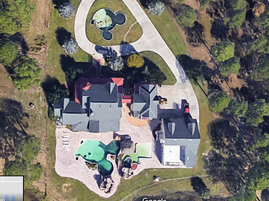 A birds-eye view shows the Mickey Mouse mansion's Mickey-shaped