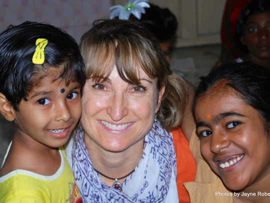 Jayne Robertson is shown in India with two girls living in a childcare home facility where they go to school and learn to make jewelry.