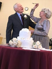 John E. Belding, 90 and Clare Bellucci, 87 celebrate their wedding.