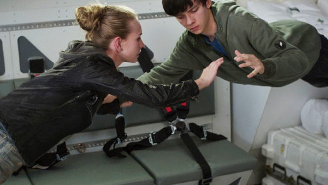 "This image released by STX Productions shows Britt Robertson, left, and Asa Butterfield in a scene from ""The Space Between Us."""