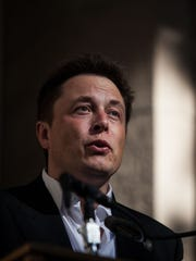 Elon Musk, CEO of Tesla Motors, speaks at a press conference at the Nevada State Capitol, Sept. 4, 2014 in Carson City, Nevada.