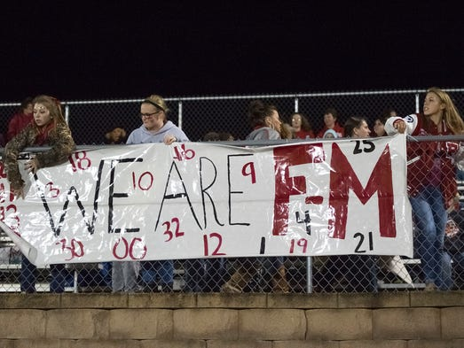 Fan's from Fannett-Metal hang up a sign in support