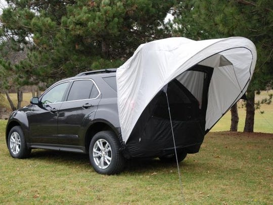 The Sportz Cove, a compact awning that attaches to