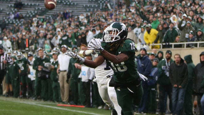 Michigan State's Felton Davis III makes a touchdown catch against Penn State's Christian Campbell during second quarter action on Nov. 4, 2017 at Spartan Stadium in East Lansing.
