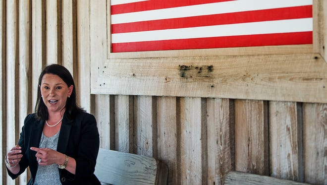 U.S. Representative Martha Roby pauses to talk with the media while campaigning at a fish fry in Andalusia, Ala., on Wednesday May 30, 2018.