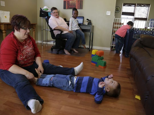 April DeBoer plays with her son Jacob as she and her partner Jayne Rowse wait for a decision in their case DeBoer Vs. Snyder to overturn the ban on gay marriage.