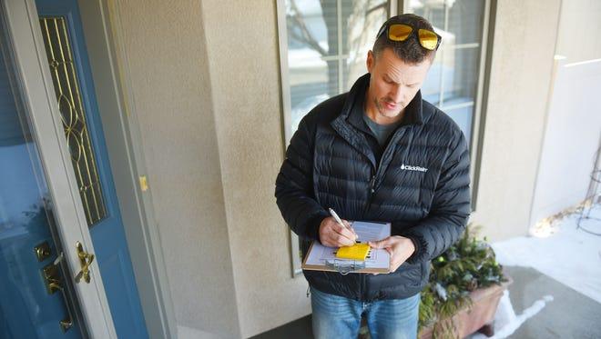 Sioux Falls Mayoral candidate Paul Ten Haken goes door to door around town Wednesday, Feb. 21, in Sioux Falls.