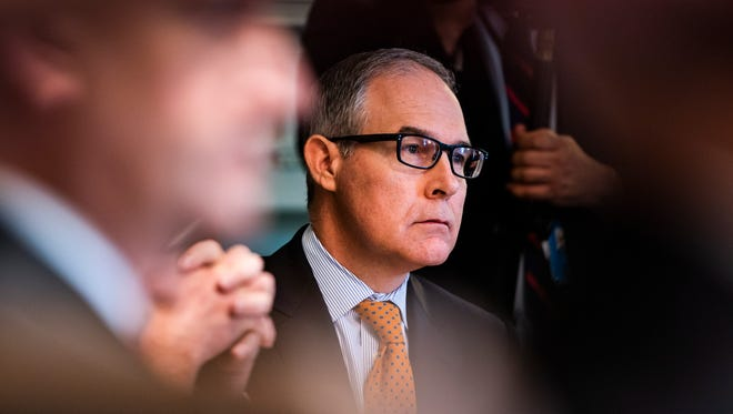 Scott Pruitt listens to President Donald Trump speak to the media before meeting with members of his administration in the Cabinet Room of the White House. Pruitt is stepping down as EPA administrator amid more than a dozen scandals.