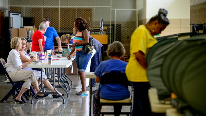 Residents get signed up to cast their ballot at Community Montessori School in Jackson, Tenn., Thursday, Aug. 2, 2018.