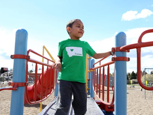 Trayson Harrell plays on the Lincoln Elementary playground on his first day back to school.