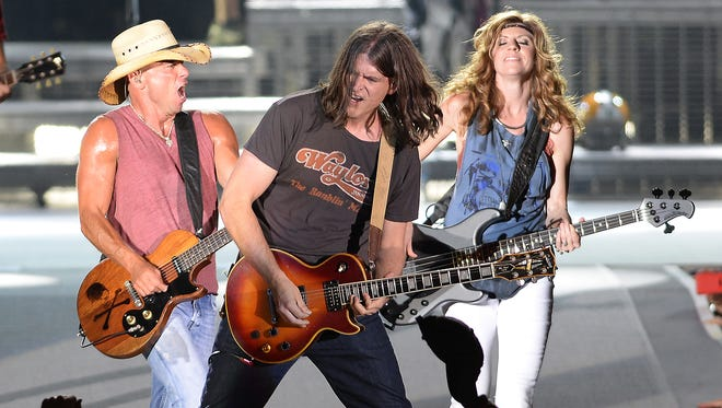 Kenny Chesney and his band performs for 50,000 fans at Lambeau Field June 20, 2015.