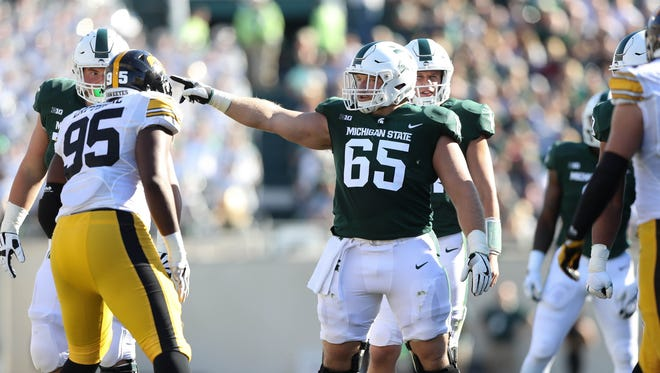 Michigan State senior center Brian Allen (65) earned second-team All-Big Ten Offense honors by both the coaches and media.