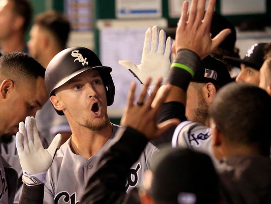 Chicago White Sox Adam Engel, left, celebrates his three-run home run during the sixth inning of a baseball game against the Kansas City Royals at Kauffman Stadium in Kansas City, Mo., Monday, Sept. 11, 2017. (AP Photo/Orlin Wagner)