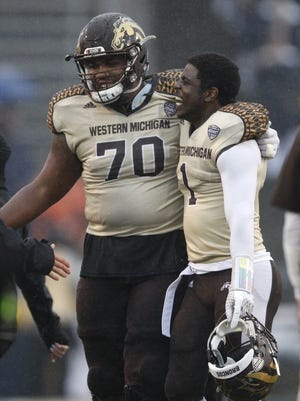 Western Michigan offensive lineman Willie Beavers (70) celebrates after a game against the Toledo Rockets.