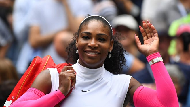 In a file photo from Sept. 3, 2016, Serena Williams waves after beating  Johanna Larsson of Sweden at the U.S. Open.