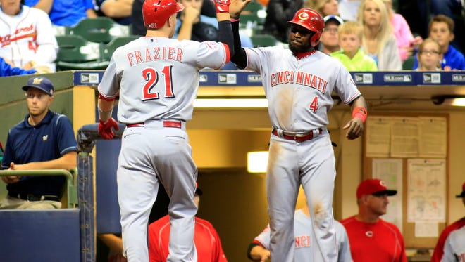 Todd Frazier is congratulated on his two-run home run by Brandon Phillips during the sixth inning.