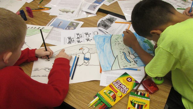 """Fourth grade students create their own habitat during the Children's Art Network's """"Home Sweet Home:  Animals and Habitats of Virginia"""" Traveling Studio Program."""