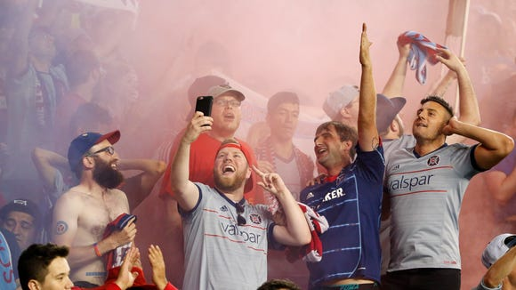 Chicago Fire FC fans cheer on the team in the second