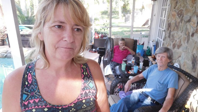 Dianna von Stockhausen is frustrated by the lack of electrical power to her home after Hurricane Irma. Behind her are her mother and father,  Gloria and William Herman.