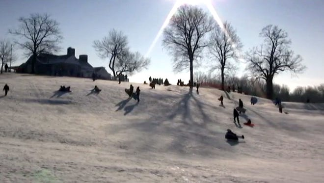 Sledders glide down the Whitnall Park Golf Course hill, which has multiple levels and pitches to explore.