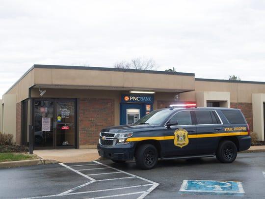 Delaware State Police investigate the scene of a robbery