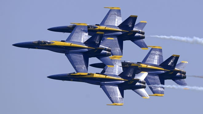 John Blackie/jblackie@pnj.com The Blue Angels fly over the crowd at Pensacola Beach on Saturday during the Blue Angels Pensacola Beach air show. The Blue Angels fly over the crowd at Pensacola Beach Saturday during the Blue Angels Pensacola Beach air show.
