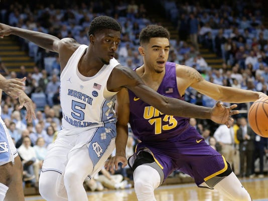 FILE - In this Nov. 10, 2017, file photo, North Carolina's Jalek Felton (5) reaches for the ball against Northern Iowa's Juwan McCloud (13) during the second half of an NCAA college basketball game in Chapel Hill, N.C. Felton's attorney said Thursday, March 1, 2018, that Felton has withdrawn from school after he was suspended from the university in January. (AP Photo/Gerry Broome, File)
