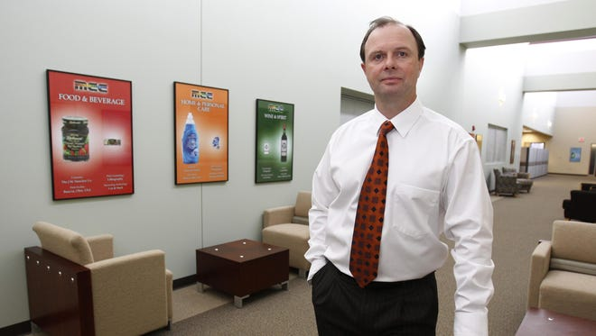 Nigel Vinecombe, CEO and president of Multi-Color Corp. is photographed in the company's headquarters in Union Township, Ohio, in 2013.