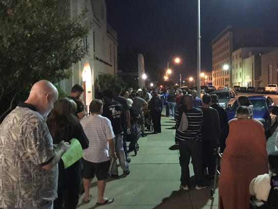 Patients queue on the sidewalk at 37 E. Beauregard Avenue, while they wait for the doors to open at the Mission of Mercy event in San Angelo, Texas, Friday, Oct. 13, sponsored by the Texas Dental Association's Smile Foundation and Methodist Healthcare Ministries of South Texas.