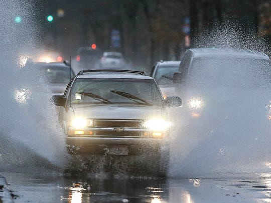 Motorists on Southern Parkway splash their way through the morning commute.