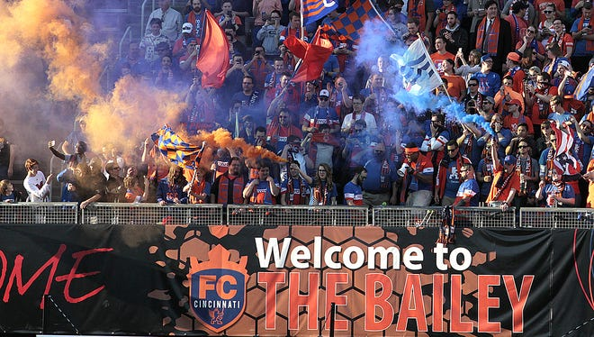 The crowd goes wild with orange and blue smoke after FC Cincinnati went up 1-0.