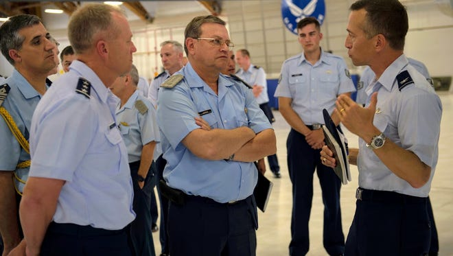 Lt. Gen. Mark Kelly, 12th Air Force commander, (left) Brig. Gen. Enrique Amrein, Argentine air force chief of staff, (center) and Col. Houston Cantwell, 49th Wing commander, (right) discuss capabilities of the MQ-9 Reaper at Holloman Air Force Base, N.M., July 20, 2017. While at Holloman, Amrein learned about the remotely piloted aircraft training program and what pilots, sensor operators and maintainers experience during their time here.