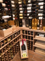 The wine cellar holds fine wines in the proper controlled