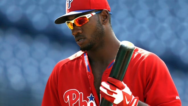 Philadelphia Phillies Domonic Brown during warmups before a baseball game with the Atlanta Braves, Friday, June 27, 2014, in Philadelphia. (AP Photo/Laurence Kesterson)
