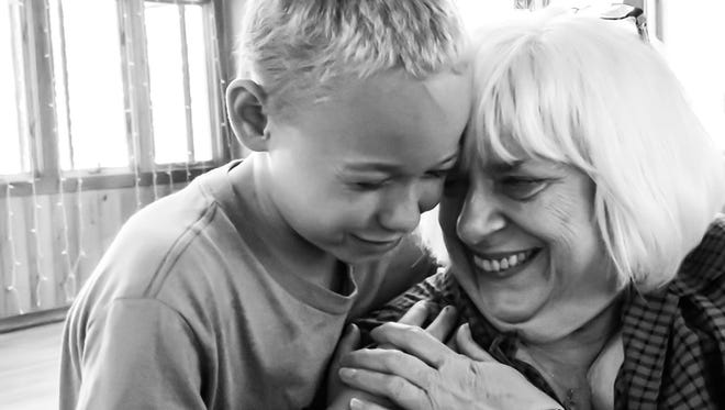 Joan C. Gill shares a laugh with patient Alex Muckerhide at Camp Klotty Pine in Wautoma, Wis. The camp is operated by the Great Lakes Hemophilia Foundation.