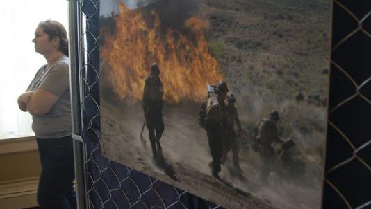 A June 30, 2014, photo shows Kristina Miller at an exhibit of Granite Mountain Hotshots in Prescott.