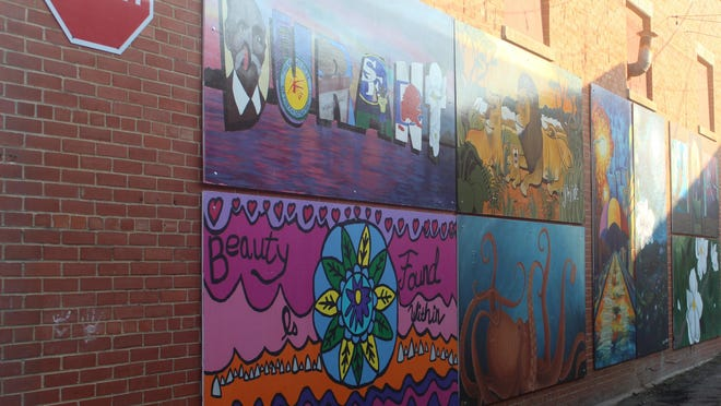 Mural panels line the wall of a building in downtown Durant as part of the Magnolia Mile Art Alley project. A competition was held during the June 5 First Friday event, when the public was allowed to vote to for their favorite piece. The mural panels are expected to remain in the space for about a year.